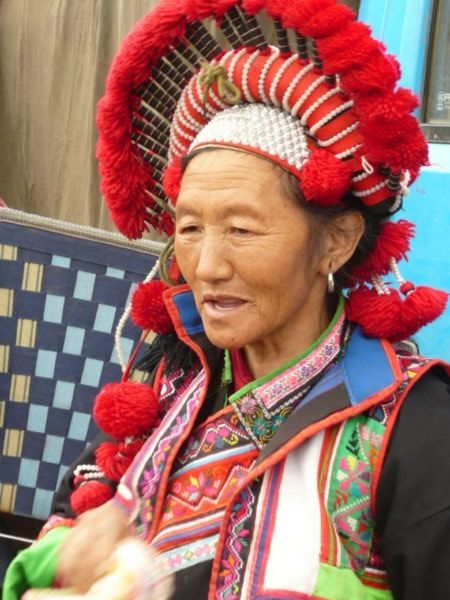 Pu Yi ethnic minority woman at Lao Zhai market, Yunnan Province, South West China