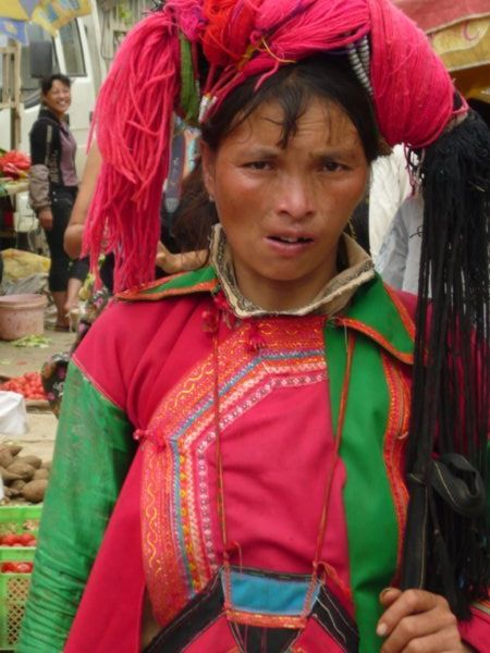 Yi ethnic minority woman at Huang Cao Ba market, Yunnan Province, South West China