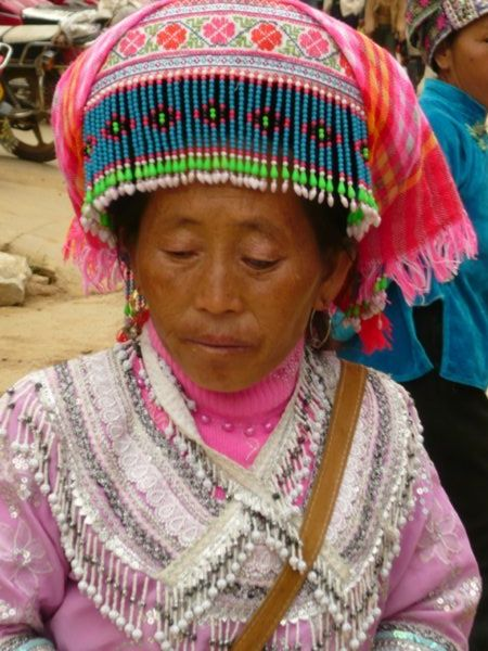Miao ethnic minority woman at Lao Zhai market, Yunnan Province, South West China